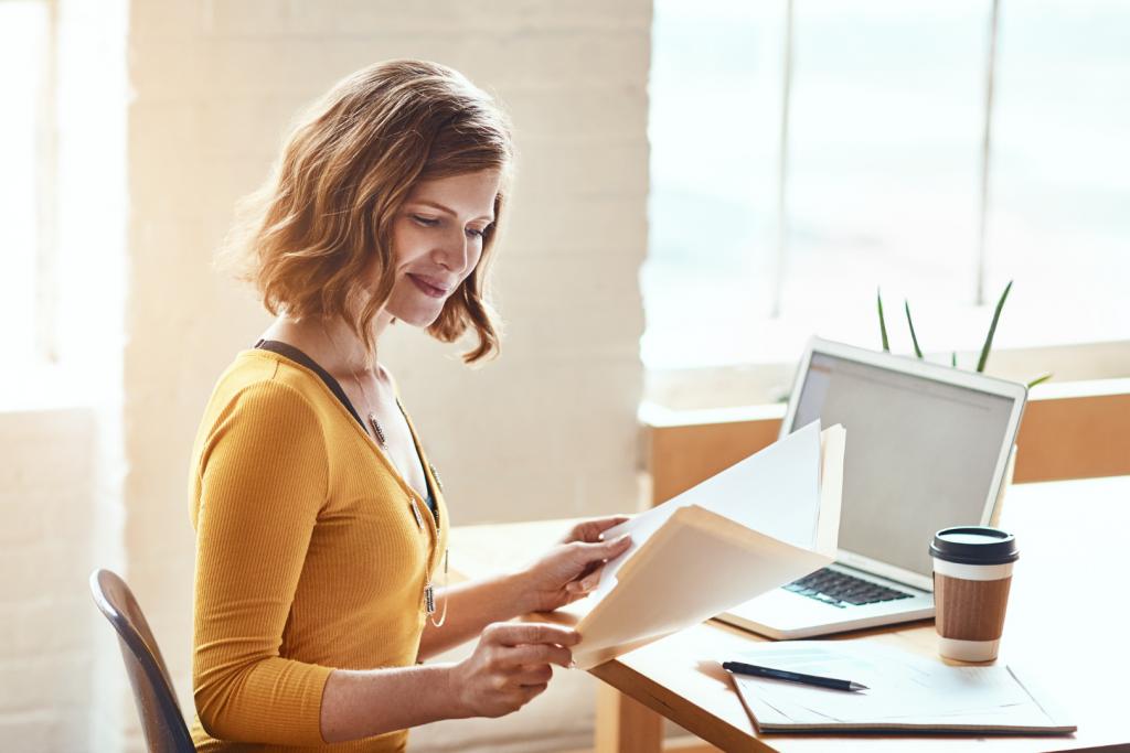 woman reading paper on folder