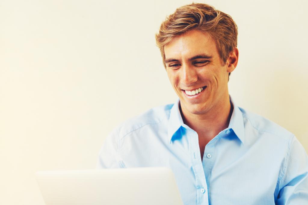 Man happy looking at good data
